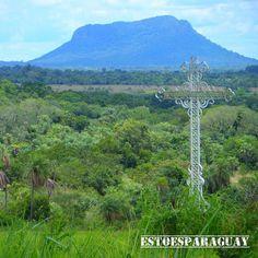 On instagram by estoesparaguay #landscape #contratahotel (o) http://ift.tt/1mPYb8Y cruz blanca en memoria de los compatriotas caidos en aquella contienda grande en el campamento cerro león Pirayú y de fondo el imponente cerro hú de Paraguarí rodeado de naturaleza. #paisajes #naturaleza #mitierra #paraguay #instamoment #instasise #instapic #sky #naturallove #naturalgram #peace #mycountry #estoesparaguay