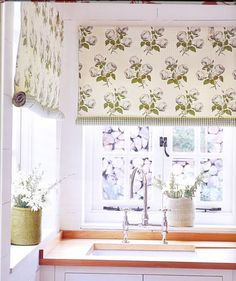 Little Green Notebook: Rolled Fabric Shades~~Will look great in the kitchen!  I love my curtains...which are three linen tea towels draped over the rod horizontally...stitched together vertically, lined in coordinating print will look fabulous and not too hard to duplicate.