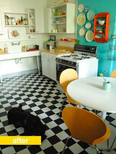 Another checkered floor, a cute plate holder turned spice rack and just to the right my favourite US kitchen accessory can be seen (a hanging fruit basket). The only thing I'm not a fan of is the open shelving.