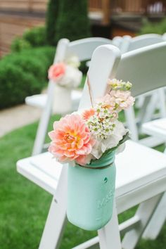 """<p>Craft this beautiful arrangement, attach yarn to the rim of the jar, and hang it to the chairs at your next outdoor party. </p><p><strong>Get the idea on <a rel=""""nofollow"""" href=""""http://somethingturquoise.com/2015/01/07/tigh-na-mara-resort-wedding/"""">Something Turquoise</a>. </strong></p>"""