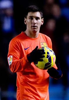 Lionel Messi of FC Barcelona holds the ball as he leaves the pitch after his hat-trick at the end of the La Liga match between RC Deportivo La Coruna and FC Barcelona at Riazor Stadium on January 18, 2015 in La Coruna, Spain.