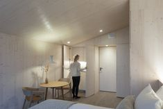 The walls, floors, and ceilings in the studio units feature pale wood finishes. #dwell #travel #microcabin #moderncabins #finland #prefab Modern Prefab Homes, Modular Homes, Modern Cabins, Timber Cabin, Recessed Spotlights, Light Hardwood Floors, Natural Wood Finish, Cozy Cottage, Finding A House