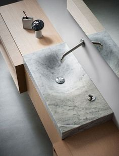 815 washbasin by Agape - mimics the natural erosion of stone by water.