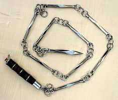 A nine-section whip,so named because it is separated into nine sections and linked together. A formidable weapon indeed.