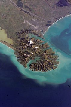 Christchurch New Zealand showing Banks Peninsula with extinct volcanos, being Lyttleton Harbour at the top and Akaroa Harbour at the bottom of the picture.