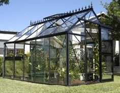 This Victory Orangery greenhouse has 101 ft² of floor space and the high vaulted ceilings allows plenty of room for trellising your tall growing plants or climb