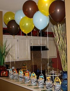 Balloons tied to kids favors. Adds balloons/color to the party plus the kids get to take them home