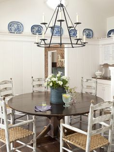 Love the blue and white brought into the room by the plates up on the rail and really like this wrought-iron chandelier