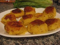 Llapingachos - seasoned potato patties seasoned filled with cheese