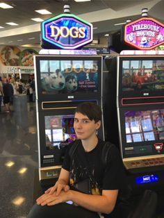 """If my soul was an image, it would be this picture of Dan Howell with a """"dogs"""" slot machine"""