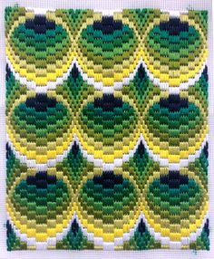 Bargello on tapestry mesh with DMC Threads. Tubes design - looks a little like peacock feathers?