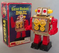 About 10 inches tall and old stock - circa the 1960's. When wound, the robot advances with turning gears and sparks. Great design. The original box (with minor shelf wear) contains all inserts. Made i