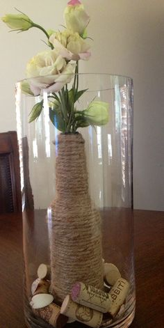 Beer bottle Rope/hemp - #joannfabric Wine corks (collected over time) Sea shells ( collected from my trip to Captiva Island,FL) Flowers  Creative unique centerpiece