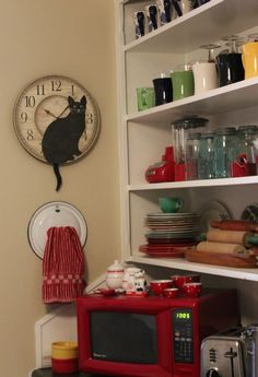 A Place To Hang Kitchen Towels - old pot lids