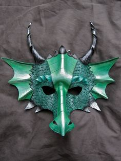 Hand-tooled leather dragon mask