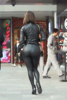 Black leather leggings bottom and leather jacket with ankle boots