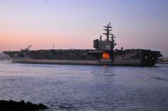 The aircraft carrier USS Ronald Reagan (CVN 76) navigates through San Diego Bay.