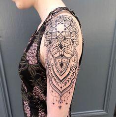 Gorgeous ornamental shoulder tattoo.