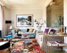 blue chesterfield loveseat + floral rug
