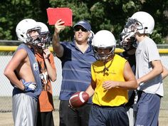 New Fairless football head coach Don Wilson goes over some plays with the offense during a practice Wednesday at Fairless High School. INDEPENDENT GLENN B. DETTMAN