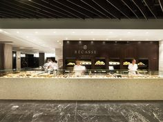 The design of a boutique bakery in a Sydney shopping mall reflects the luxury of the pastries which it sells.