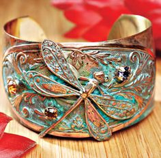 Dragonfly Cuff.      Looking for that perfect statement accessory? Something that stands out from all the rest of your jewelry. This beautiful dragonfly cuff bracelet was made for you. Handcrafted solid brass with a triple layered patina bring out the deep brassy and cool blues of the bracelet.