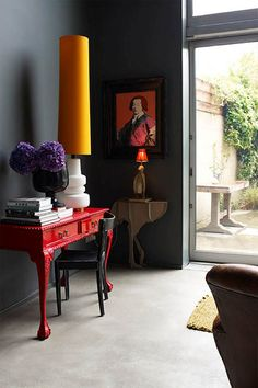 These brave dark walls work brilliantly with the splashes of colour