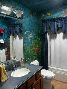 Shark and fish on a bathroom wall. Underwater mural. Awesome!