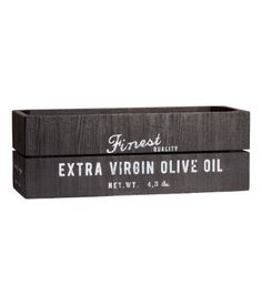 Antique-finish wooden box with a printed text design. Protective pads on base. Appearance can vary slightly from product to product. Size 4 x 4 x 11 3/4 in.