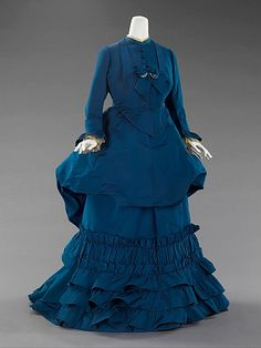 Dress, Afternoon  House of Worth  (French, 1858–1956)    Designer:      Charles Frederick Worth (French (born England), Bourne 1825–1895 Paris)  Date:      ca. 1872  Culture:      French  Medium:      silk  Dimensions:      Length at CB (a): 46 in. (116.8 cm) Length at CB (b): 56 in. (142.2 cm)  Credit Line:      Brooklyn Museum Costume Collection at The Metropolitan Museum of Art, Gift of the Brooklyn Museum, 2009; Gift of Margaret D. Leverich, 1964  Accession Number:      2009.300.3259a, b