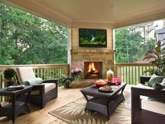 The view may be pretty, but don't forget about the entertainment and seating. Make plans early in the design of your  outdoor fireplace spot  to add a TV over the mantle, if you or other homeowners want to watch sports, movies or even cartoons outdoors.