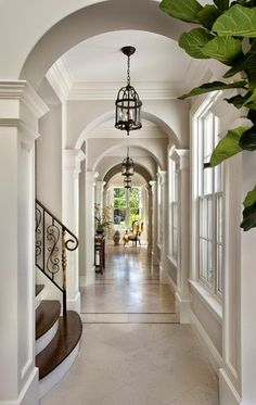 Stunning hallway with white wood panelling trim inlaid marble floors