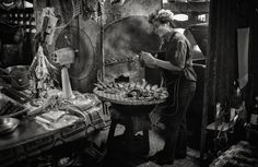 Fish vendor by Lee Craker, via 500px.