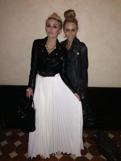 Pleated white dress/skirt with black leather jacket and goldaccessories. Miley Cyrus and mom