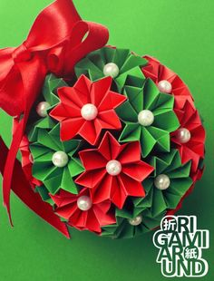 """origamiaround: """"Christmas origami venus kusudama with pearls and a ribbon. It was a gift for my cousin's family. The units are the same as the venus cactus' and I have a tutorial for that one. Christmas Origami, Christmas Crafts, Christmas Ideas, Parts Of A Flower, Origami Flowers, Photo Link, Crepe Paper, Flower Making, Cactus"""