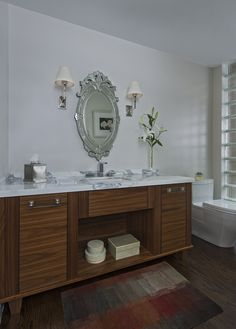 Beautiful walnut wood vanity by Millennium.