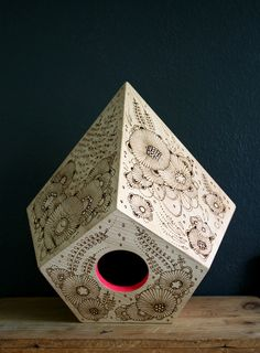Birdhouses with gorgeously intricate wood burning patterns, from Yellena James.