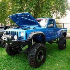 Lifted Blue Jeep Truck MJ with Baja lights and winch... need!