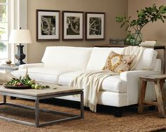 White sofa, cozy white throw, soft blue and green pillows....add his brown leather recliner