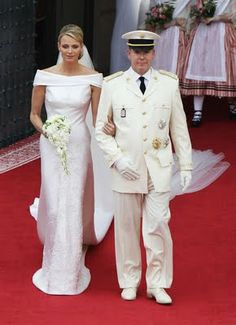 Prince Albert finalized his marriage to Princess Charlene in the cream summer uniform of Monaco's Palace Guards. The buttons feature the Prince's monogram, and he wore medals of the Order of Saint Charles, the Order of Grimaldi, and the French Legion of Honor