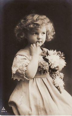 1910...Sweet Little Girl....Curly Hair....Flower Bouquet...Victorian...original vintage postcard