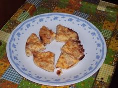 Taste Better than they Look Crab Puffs!!!  1 can or 6oz of cooked crab meat.   1/4 cup chopped onion  2 jar of Kraft Old English Sharp Pasteurized Process Cheese Spread.    1 Stick of Butter or margarine, Softened        1/4 Tsp Garlic Powder        1 package of Thomas English Muffins  Mix all ingredients except English muffins  Split muffins  top generously with mix   Freeze rounds  Quarter the rounds  Bake till golden and slightly crispy or freeze in a ziplock for last min Party food!!!