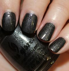 """China Glaze """"Stone Cold"""". Occasionally I like to rock the charcoal/black look and this looks a little more feminine with its glitter than a flat charcoal color."""