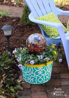 Brittany from Pretty Handy Girl stenciled an ice bucket with the Chez Sheik Stencil and created a garden planter!