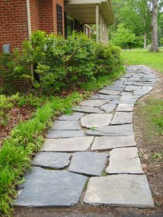 """""""Recycling"""" old slate to create a newer, neater path to our door"""