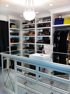 I want a closet like this..like a little boutique.  Nothing huge and crazy, but everything has a place..love that chandalier!  And I have to have at least one Hermes chillin on the shelf lol