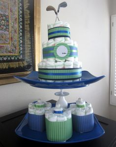 How to make a diaper cake.  This one is golf themed for a co-ed baby shower :)