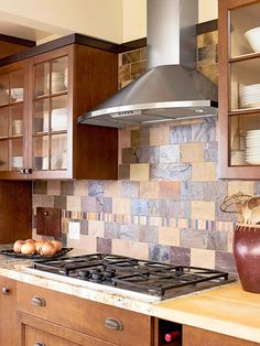 Here, slate tiles in a mix of brown and blue tones create a lively backsplash that serves as the focal point of this kitchen. The tiles also add color to an otherwise all-brown kitchen and texture, as two different types of slate were used to achieve the desired combination.