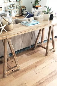We love this furniture flip. See how this upcycled console gets a farmhouse rustic makeover for her living room decorating on a budget.