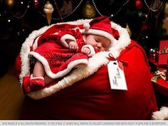 Baby wearing Christmas outfit & lying in Santa's Toy bag